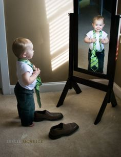 This was the mom's idea to have him play dress-up with daddy's clothes. ended up being a really cute shot.  I think if I do this I would take the picture like this and then when they are older (hopefully in the same clothes) and superimpose the older picture into the mirror.