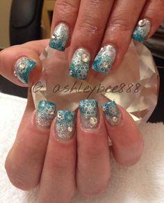 Winter wonderland gel nails with Swarovski crystals