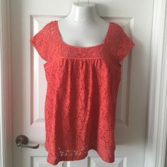 Ann Taylor LOFT Blouse This large red orange Ann Taylor LOFT Blouse is in great condition. It has short sleeves and it features a square neckline. The shell is 99% nylon and 1% spandex and the lining is 100% cotton. Let me know if you have any questions! LOFT Tops Blouses