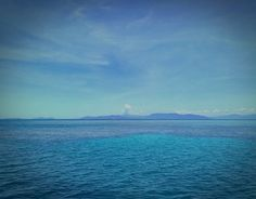 This is the Great Barrier Reef! Can you see its shade just underwater? #GreatBarrierReef #Cairns #queensland #thisisqueensland #australia #sea #ocean #coral #reef #nature #water #sky #blue #travelblogger #travelstoke #iamtb #catalanspelmon #instatravel #travelblog #travel #wanderlust #diving #scubadiving #snorkel #swim #7naturalwonders #wonderful #stunning by travelgastronaut http://ift.tt/1UokkV2