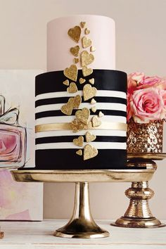 9. Blush and gold are always a show stopping combination, and this beautiful design from De La Creme Creative Studio is stealing our hearts, all 30 of them, with it's sparkly accents and tailored black and white stripes.