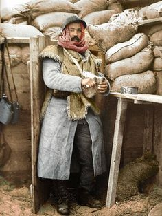 A Poilu wearing a sheepskin jerkin, stands in a shelter made of sandbags. Nieuwpoort,Belgium, c 1915. -WW1 colorized photos - Album by gilber on Imgur