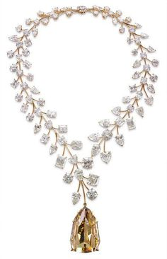 The most expensive necklace in the world $55 million; the big yellow diamand is 407.48 carats and all other together are 637 carats, from iryna