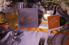 table numbers by gretchenberry.com  citrus orange and green wedding decor ideas and inspiration from Urbane Montage Events and Cadence Cornelius Photographs  via junebugweddings.com