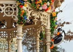 Colorful Flowers and Penguins from Mary Poppins decorate the Gazebo at Town Square during Swing into Spring, Disneyland Paris