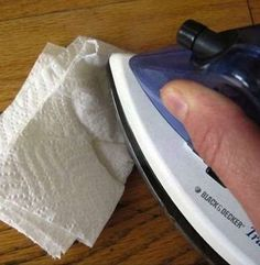 Fix dented hardwood floors with steam iron