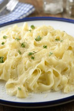 Low Calorie Fettuccine Alfredo Recipe using 2% milk, low-fat cream cheese and parmesan cheese
