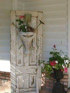 Use an old door for display for wreaths or just as a prop for any kind of room divider. by robindu Old Door Decor, Old Door Projects, Recycled Door, Vintage Baskets, Garden Doors, Old Windows, Old Doors, Salvaged Doors, Porch Decorating