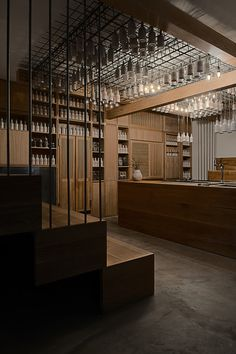 """Bar Gamsei München. """"Dangling from the ceiling...are ceramic bottles containing drinking vinegars, kombuchas, and syrups, all made with ingredients foraged or grown around Munich.""""-Camper English, Saveur, Jan/Feb 2014"""