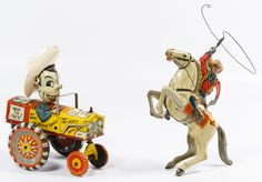 """Lot 526: Marx """"Lone Ranger"""" and """"Milton Berle"""" Wind-up Tin Toys; Lone Ranger is dated 1938, Milton Berle is c.1940, each having stamped maker mark and key"""