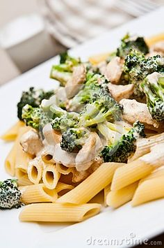 A delicious dish of pasta with chicken and broccoli. Elegant table setting.