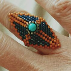 Peyote triangle ring with a small turquoise bead
