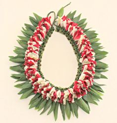Holiday Lei - Braided two colors flowers together!