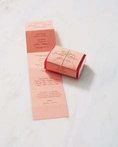 Fold a programover a mini tissue pack ($0.50, USImprints.com). Tie it with colored twine to make it as pretty as it is practical.