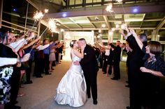 A sparkler exit is the perfect way to end the night!  Photo by Joel Cookston Photography.  #Indianapolis #wedding #venue #IndianaStateMuseum