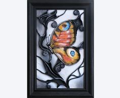 "Hand Painted Leather Peacock Butterfly Wall Art Decor Picture, Wooden Frame, Acrylic Paste Relief Background, Leather Ornaments, 3D Picture, 3D Painting. This piece of art is inspired by Peacock butterfly. Materials: wood, leather, acrylic paste and acrylic paint. Size: 27cm (width) x 39cm (height) | 10.62"" (w) x 15.35"" (h) Unique hand-painted leather wall art with a wooden vintage style black frame portraying a colorful butterfly on black-and-white background. Painted with metallic…"