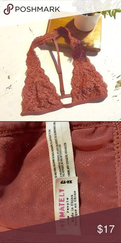*Free People* Bralette Lace halter bralette with t-back. Beautiful rust color with a slight sheen.  Perfect condition! Size XS Free People Intimates & Sleepwear Bras