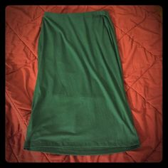 Long green pencil skirt Great condition, never worn. Stretchy and comfortable yet stylish. Hidden elastic waist, hits below knee bobeau Skirts Pencil
