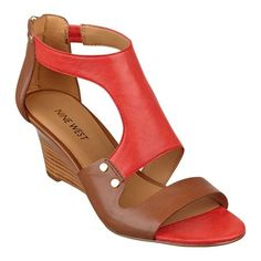 """Cool color blocking and a unique T-strap design elevate our Rooster wedge sandals lifted with a 2 3/4"""" high stacked wedge heel. Back-zip closure. Padded footbed for all-day comfort. Leather upper. Man-made lining and sole. Imported. Peep toe wedge sandals. Shoes for women."""