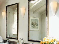 sconces provide overall illumination in this bathroom