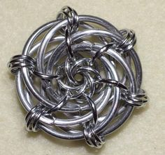 Grandma's Rose by Mellsy11; #maille #pendant interlocking large and small mobius balls.