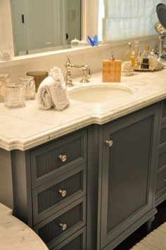 Doing a dark grey cabinet would look very pretty with your stone and tile choices.  I also like the edging detail and shape of this marble vanity top