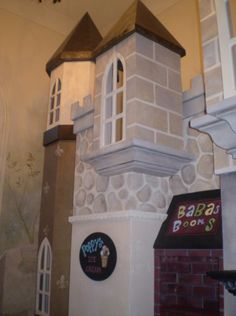 The Castle was given a village-like quality in it's paint scheme. The features on the lower level were painted to look like shops.