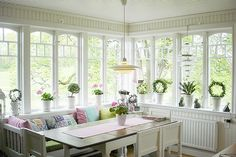 i love this eating nook especially all the wonderful windows letting in the sunshine.