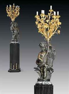 A PAIR OF FRENCH ORMOLU AND PATINATED-BRONZE SEVEN-LIGHT CANDELABRA REPRESENTING SUMMER AND AUTUMN, ON EBONY PEDESTALS THE PUTTI CAST FROM MODELS BY MATHURIN MOREAU (1822-1912), THE CANDELABRA BY HENRI PICARD, PARIS, SECOND HALF 19TH CENTURY
