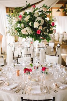 Towering crystal vases were topped with lush arrangements of ivy, ivory hydrangeas, and roses in various shades of pink. #receptiondecor Photography: James Christianson. Read More: http://www.insideweddings.com/weddings/summer-destination-wedding-with-rocky-mountain-views-in-aspen-co/642/