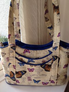 Cotton canvas butterfly bag with contrast piping