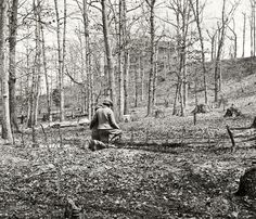 """Prince William County, Virginia. """"Along Bull Run near Sudley Church. March 1862."""" Each of the dozen or so sticks lined up in front of the boys marks a grave. Wet plate glass negative by George N. Barnard."""
