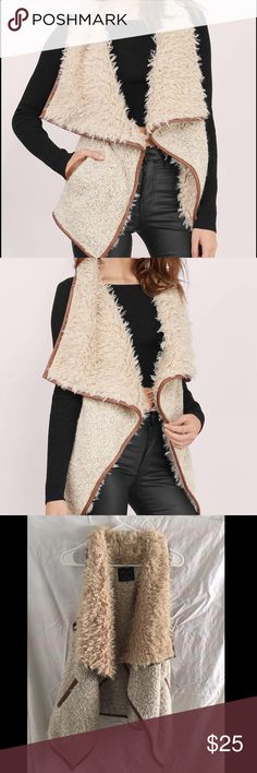 TOBI Keep It Cozy Vest This is brand new, never been worn, with tags! Chic meets cozy with the Keep It Cozy Shearling Vest. This piece is lined with furry shearling to accompany a draped silhouette. Wear over a long sleeved bodycon and booties. Tobi Jackets & Coats Vests
