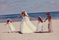 Shop David's Bridal for the perfect bridal party looks for any beach affair. #beachwedding #bridalgown #bridesmaids