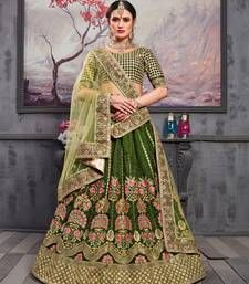 Create your own style statement wherever you go by wearing a latest fashion pine Green Color Heavy Designer Bridal Lehenga Choli that delicately crafted with thai silk and bridal net fabric and embroidered work. Bridal Lehenga Online, Designer Bridal Lehenga, Lehenga Choli Online, Bridal Lehenga Choli, Indian Lehenga, Silk Lehenga, Anarkali, Silk Sarees, Saris