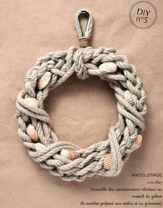 Braided Rope Wreath with Shells Tucked in: http://www.completely-coastal.com/2016/06/nautical-rope-wreaths.html