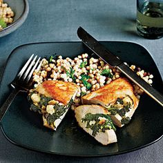 Chicken Stuffed with Spinach, Feta, and Pine Nuts Recipe.  Very good but I totally changed the recipe to cook quicker....slightly wilt spinach in pan.  saute s seasoned cubed chicken in chicken broth and garlic.  Add wilted spinach in last couple of minutes.  Top with feta