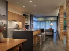 Modern Kitchen with Flush, Undermount Sink, European Cabinets, Quartz counters, Kitchen island, Concrete floors, One-wall