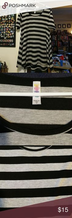 LuLaRoe Perfect T Size M Grey/Black Stripes Great! LuLaRoe Perfect T in size medium. Worn a few times and washed to LLR specifications. Has some slight pilling on the backside. Really great shirt; selling it because it's not getting the love it deserves sitting in my closet. Check out my other items and bundle to save! LuLaRoe Tops Tees - Short Sleeve