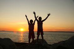 Children praising God during a sunset