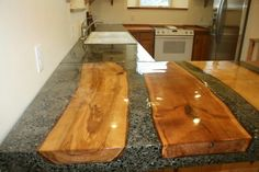 I LOVE this wood inlay on these concrete kitchen countertops!