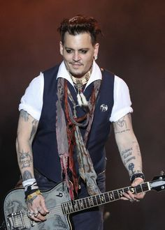 Johnny Depp Photos - Actor/Musician Johnny Depp of Hollywood Vampires performs onstage at Hessentags-Arena during the 56th Hessentag on May 29, 2016 in Herborn, Germany. - Hollywood Vampires Perform at Hessentag in Herborn