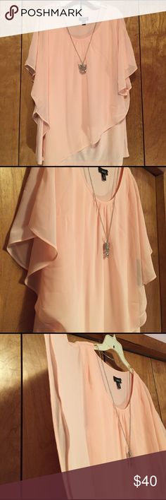 "Sleeveless layer top in a beautiful Peach color A beautiful Peach sleeveless layered top. Tank is 95% rayon 5% spandex. Overlay is 100% polyester. 30"" shoulder to hem. 22"" pit to pit. But stretchy. Bundle to get your best deal.  Necklace included ALYX Tops Tunics"