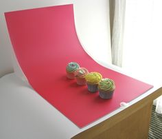 Great idea to shoot food photography without expensive backgrounds! Scrapbook paper?