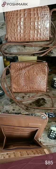 BEAUTIFUL LEATHER CROSSBODY BAG BEAUTIFUL LEATHER CROSSBODY BAG IN EXCELLENT CONDITION HAS LOTS OF POCKETS, ALSO HAS MAGNETIC CLOSURE MEASUREMENTS ARE 8.5 INCHES ACROSS AND 7.5 INCHES IN HEIGHT UP AND DOWN. SEND OFFERS IF YOU LIKE Bags Crossbody Bags