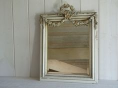 French antique 19th Mirror Louis XVI Marie-Antoinette , fronton with ribbon, garlands of flowers.  Great mirror, in a pure style Louis XVI gilt fronton and gesso, with ribbon, pearls and garlands of roses. Superb fronton. In very good antique condition, of course some pieces of wood and part of gesso are missing, please have a look at the pictures and enlarge them. But every part is solid, nothing move even it has some cracks in the gesso.  I cant see any restoration apart from the back…