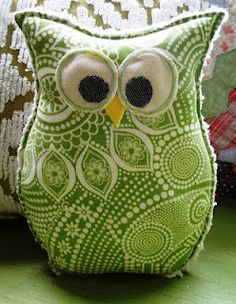 owl pillow (Button Bird Designs).  Looks like it would be easy enough to make a simple pattern for this.  Could probably hand sew a small version of this.