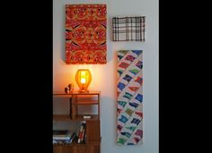 Affix scarves or favorite fabrics over canvas stretchers to create wall decor.