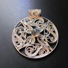 Annabel Alleyne  http://www.etsy.com/listing/73372196/handmade-solar-waltz-sterling-silver?ref=v1_other_1