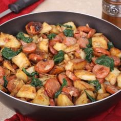 Kielbasa And Potato Skillet - baby red potatoes - kielbasa - onion - 2 garlic cloves - olive oil - brown sugar - Dijon mustard - dried thyme - baby spinach